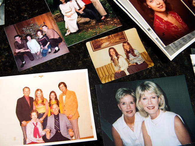 Family photos including Jean Nance lay across the counter of Mike and Sandy Dunn's home. Nance worked for TVA for decades, but died of leukemia six years after being exposed to toxic coal ash at the TVA's Kingston Fossil plant.