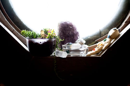 Decorations sit on a window sill at Body Mind Realign, 111 N. Central, in Knoxville, Tennessee on Tuesday, December 18, 2018. George is opening a spa in West Knoxville along with her chiropractic business which will focus on alternative medicines.