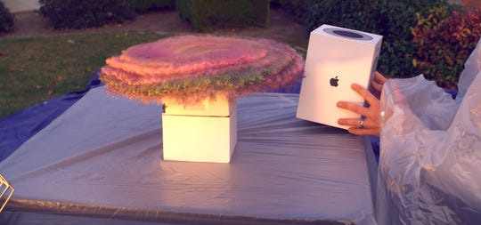 """A screenshot from Mark Rober's """"Package Thief vs. Glitter Bomb Trap"""" video shows the booby trap being triggered."""