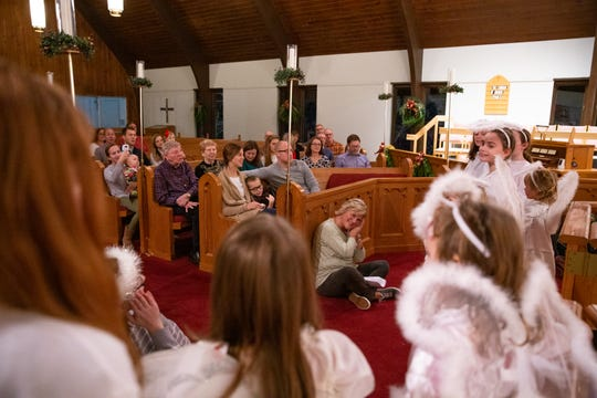 Director of Christian education Ann Backus, center, guides the angels through a song during the children's Nativity pageant at Episcopal Church of the Good Samaritan in Knoxville on Sunday, Dec. 16, 2018.