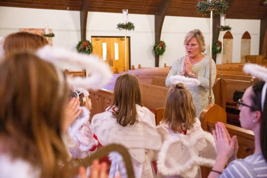 Director of Christian education Ann Backus guides children through a song during rehearsal for the children's Nativity pageant at Episcopal Church of the Good Samaritan in Knoxville on Sunday, Dec. 16, 2018. Backus said this is her 25th year directing the pageant and that her own children participated when they were young.