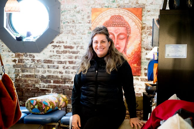 Chiropractor Dr. Jane George poses for a photo in her business, Body Mind Realign, 111 N. Central, in Knoxville, Tennessee on Tuesday, December 18, 2018. George is opening a spa in West Knoxville along with her chiropractic business which will focus on alternative medicines.