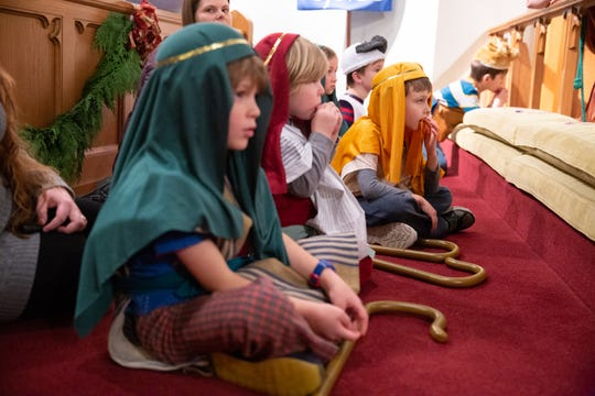 A row of children playing shepherds and animals wait their turn to play their parts during the children's Nativity pageant at Episcopal Church of the Good Samaritan in Knoxville on Sunday, Dec. 16, 2018.