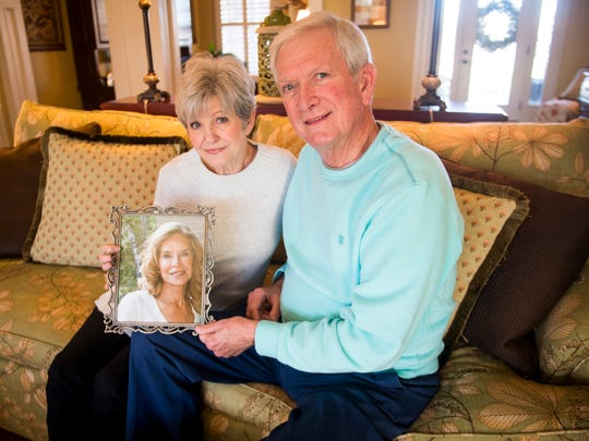 Sandy and Mike Dunn hold a portrait of Jean Nance at their Alcoa home.