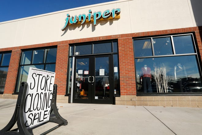 Store closing sign is posted outside Juniper, 340 E. State Street Tuesday, December 18, 2018, in Wabash Landing in West Lafayette. The popular women's boutique is closing its doors.
