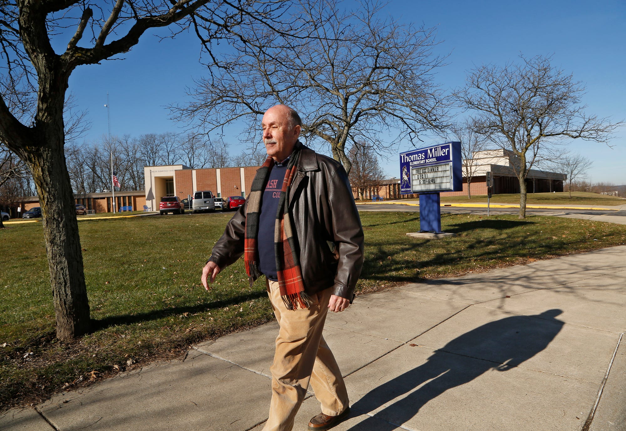 Attorney Kent Moore strolls past Miller Elementary School Tuesday, December 18, 2018, at 700 S. 4th Street in Lafayette. Moore is retiring after serving 44 years as the attorney representing Lafayette School Corp and 50 years in private practice. All five of Miller's children attended Miller Elementary.