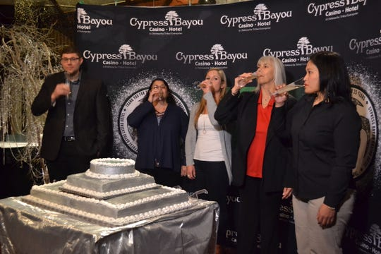 Cypress Bayou Casino stakeholders toast during a Dec. 18 reception at Mr. Lester's Steakhouse in honor of the casino's 25th anniversary.