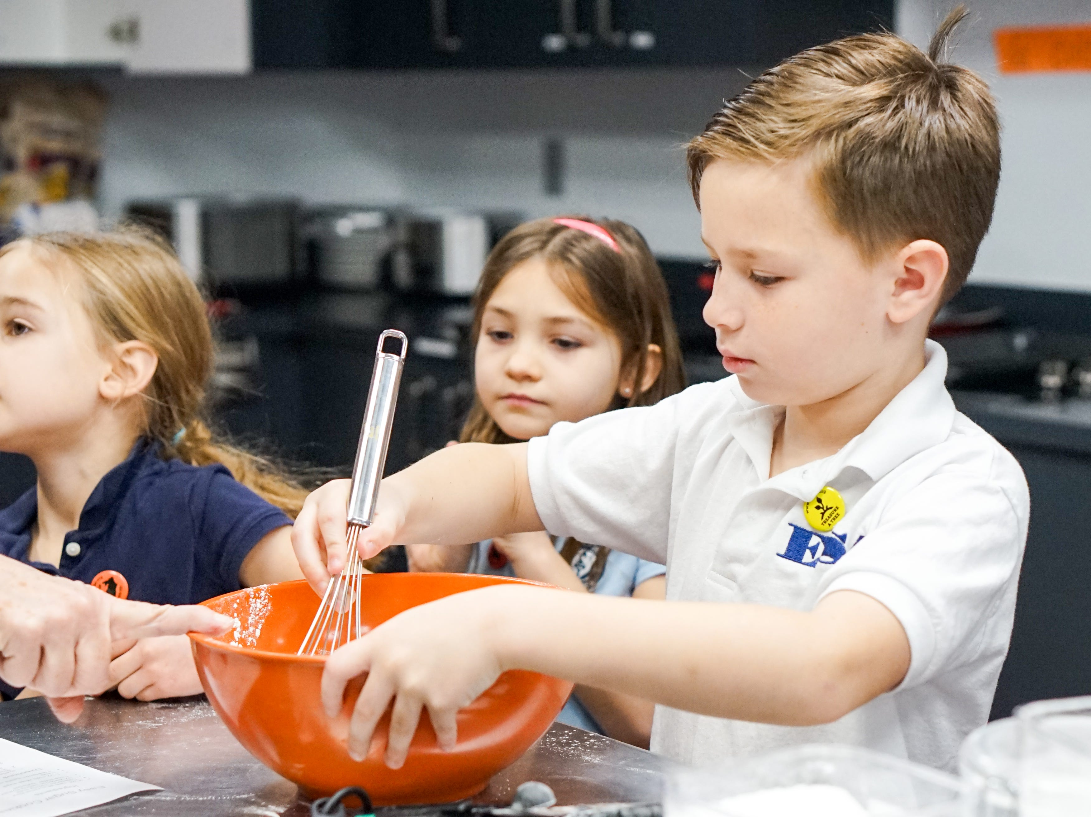 Episcopal School of Acadiana  students bake 1,000 cookies to help send a girl to school in a developing country.