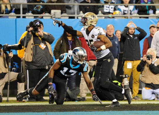 New Orleans Saints' Eli Apple (25) celebrates his interception as Carolina Panthers' Devin Funchess (17) watches in the first half of an NFL football game in Charlotte, N.C., Monday.