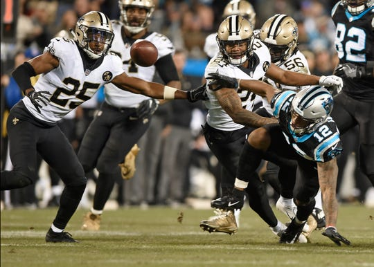 Carolina Panthers' D.J. Moore (12) fumbles the ball after being hit by New Orleans Saints' Vonn Bell (24) in the second half of an NFL football game in Charlotte, N.C., Monday, Dec. 17, 2018. New Orleans recovered the ball.