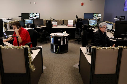 Dispatchers Kevin Roby, left, and and Ted Duffus take calls Tuesday afternoon, Dec. 18, 2018, in the Fairfield County Sheriff's Office dispatch center.