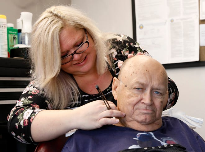 Rebecca Brown shaves the back of Charles Matthews' neck Tuesday morning, Dec. 18, 2018, at Buddy Joe's Barber and Beauty Shop in Lancaster. Brown and Angela Francis recently opened the shop on East Sixth Avenue in Lancaster.