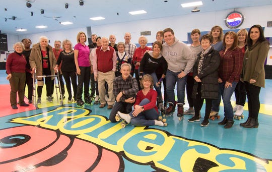 "Adult skaters known as ""The Mix"" assemble for a photo Monday, Dec. 17, 2018 after a skating event at Genoa Township's Rollerama."