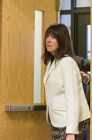 Judge Theresa Brennan enters a Livingston County Courtroom for her arraignment Tuesday, Dec. 18, 2018.