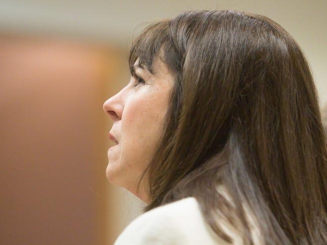 Judge Theresa Brennan listens to Genesee County Judge G. David Guinn during her arraignment Tuesday, Dec. 18, 2018.