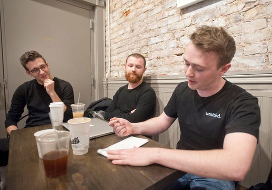 From left, Connor Gaffney, Kramer Caswell and Aaron Peabody take a break from their company, Untitled, to have coffee at Quill's Coffee Shop on Main Street.