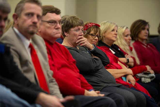 Kentucky Education Association members watch a legislative committee meeting during the special session called by Gov. Matt Bevin in December.