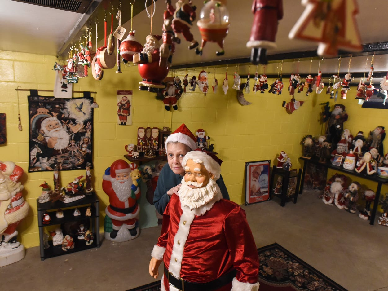 Lansing grandmother Lisa Coffman has been collecting Santas for nearly 30 years.  She estimates there are 2,000 - 3,000 santas in her collection.
