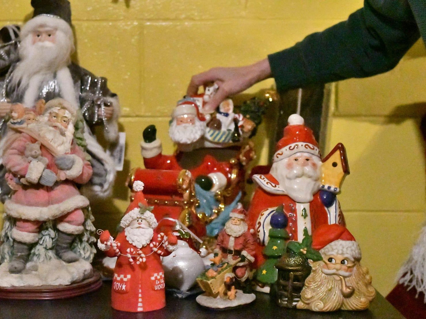 Some of the Santas in Lansing resident Lisa Coffman's collection of 2,000 plus Santa Claus'.