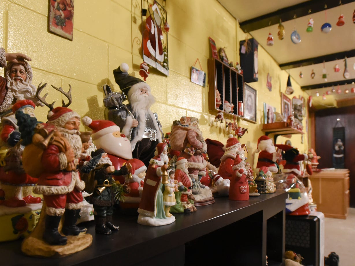 Some of the Santas in Lisa Coffman's Santa collection.  She has been collecting for about 30 years.