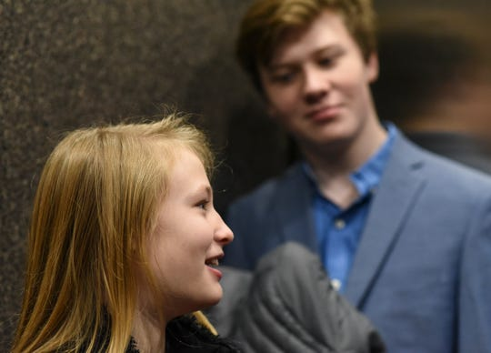 John Miller of Okemos smiles at sister Ava, 10, as they ride the elevator up to see Ingham County Probate Judge George Economy at Veterans Memorial Courthouse in Lansing.  Ava later stood before Economy who made her adoption official.  Economy has done adoption week 32 of his 33 years on the bench.