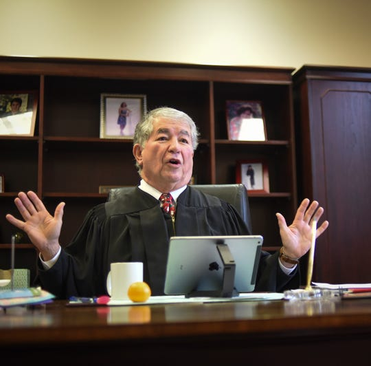 """""""I'm going to have to learn how to retire,"""" Ingham County Probate Judge George Judge Economy said Tuesday, Dec. 18, 2018, in his chambers while reflecting on his career. He has hosted a special adoption week 32 of his 33 years on the bench."""