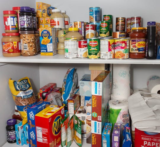 Stocked pantry by volunteers with the 'One Church One Family' program before arrival  of the family Dec. 12, 2018.
