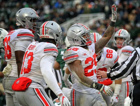Ohio State running back Mike Weber, celebrating a touchdown against Michigan State, announced on Twitter he will skip his final season with the Buckeyes, but that didn't change his feelings about wanting to play in the Rose Bowl.