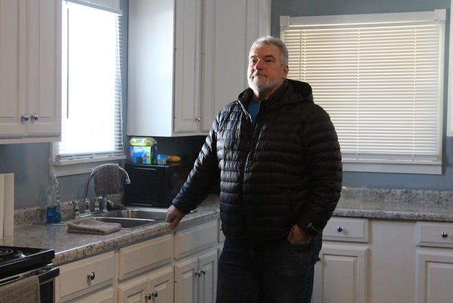 Robert Chafin, a local landlord, bought a house that had been abandoned after a fire badly damaged it from the Marion County land bank for $3,000. In a few months, he renovated it and now rents it out.