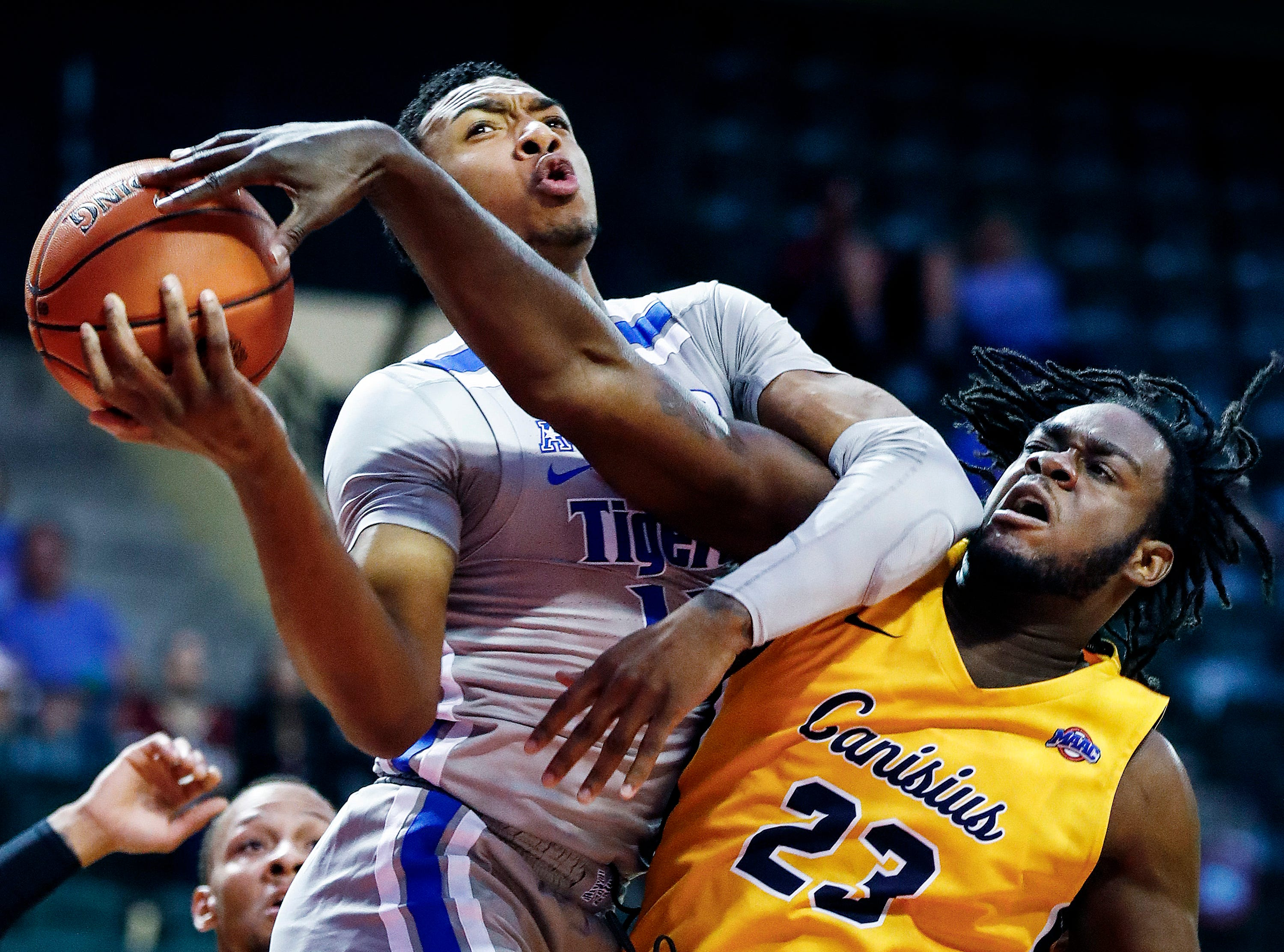Memphis guard Antwann Jones (left) has his shot blocked by Canisius defender Dantai St. Louis (right) during second day action in the Advocate Invitational in Orlando Friday, November 23, 2018. Jones was able to recover the ball and score a layup on the play.
