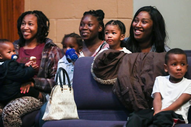 December 18 2018 - Brittany Seay, right, holds her son, Kyrie, during the first graduation for the Agape Thrive by Five program. Agape is a local nonprofit agency which works with children and parents to promote brain development.