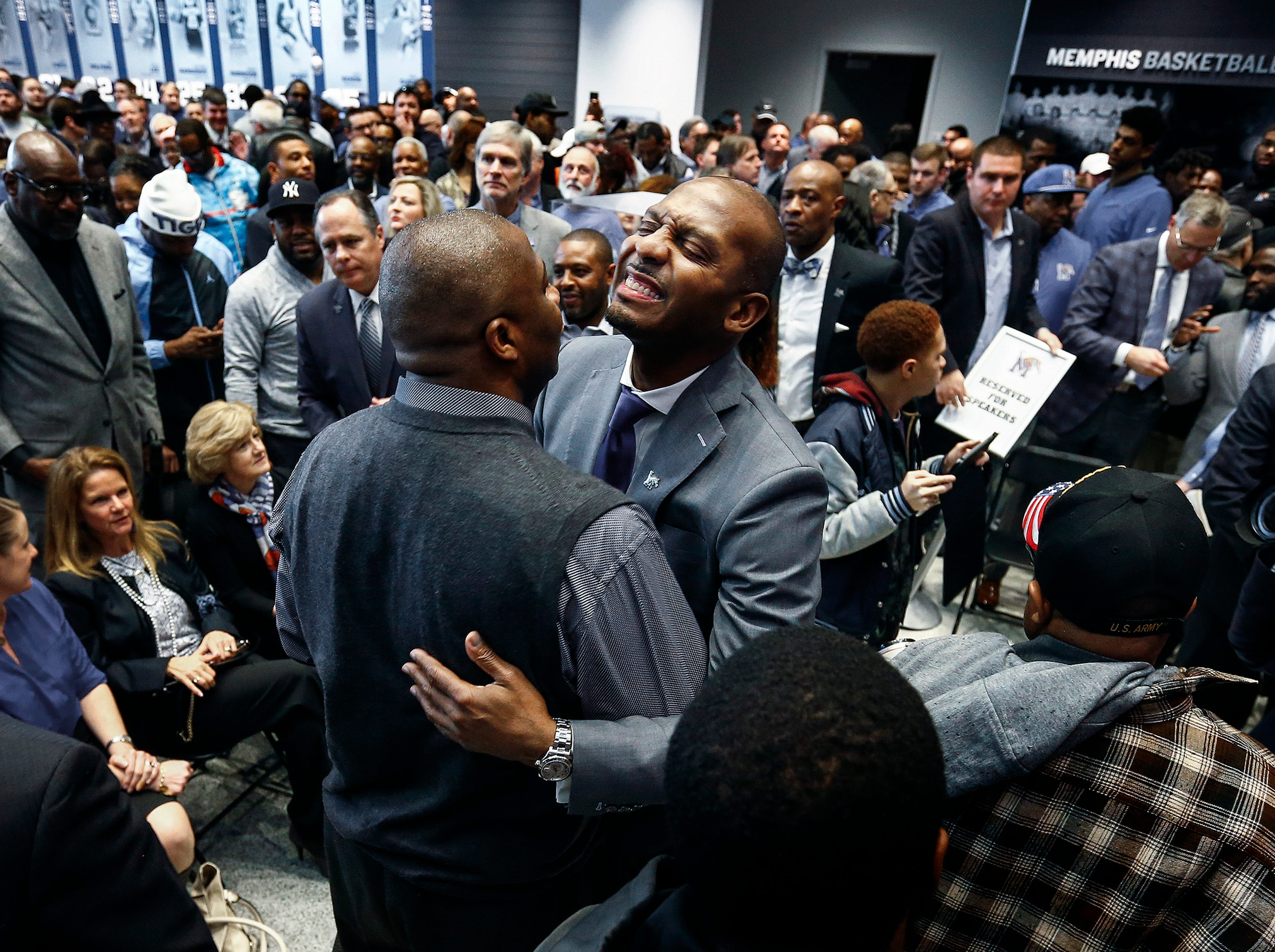 """Anfernee """"Penny"""" Hardaway smiles while getting hugs from Tigers fans after introduced as the University of Memphis' new head basketball coach at the Laurie-Walton Family Basketball Center Tuesday morning. Hardaway, who a standout player at the U of M from 91-93, will take over for recently fired head coach Tubby Smith."""