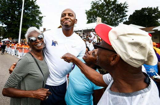 Memphis Tigers head coach Penny Hardaway speaks to a crowd gathered at the Classic Parade along Park Ave presented by the Orange Mound Parade Committee. Thousands lined Park Ave to see the parade that featured area high school marching bands among numerous other marchers.