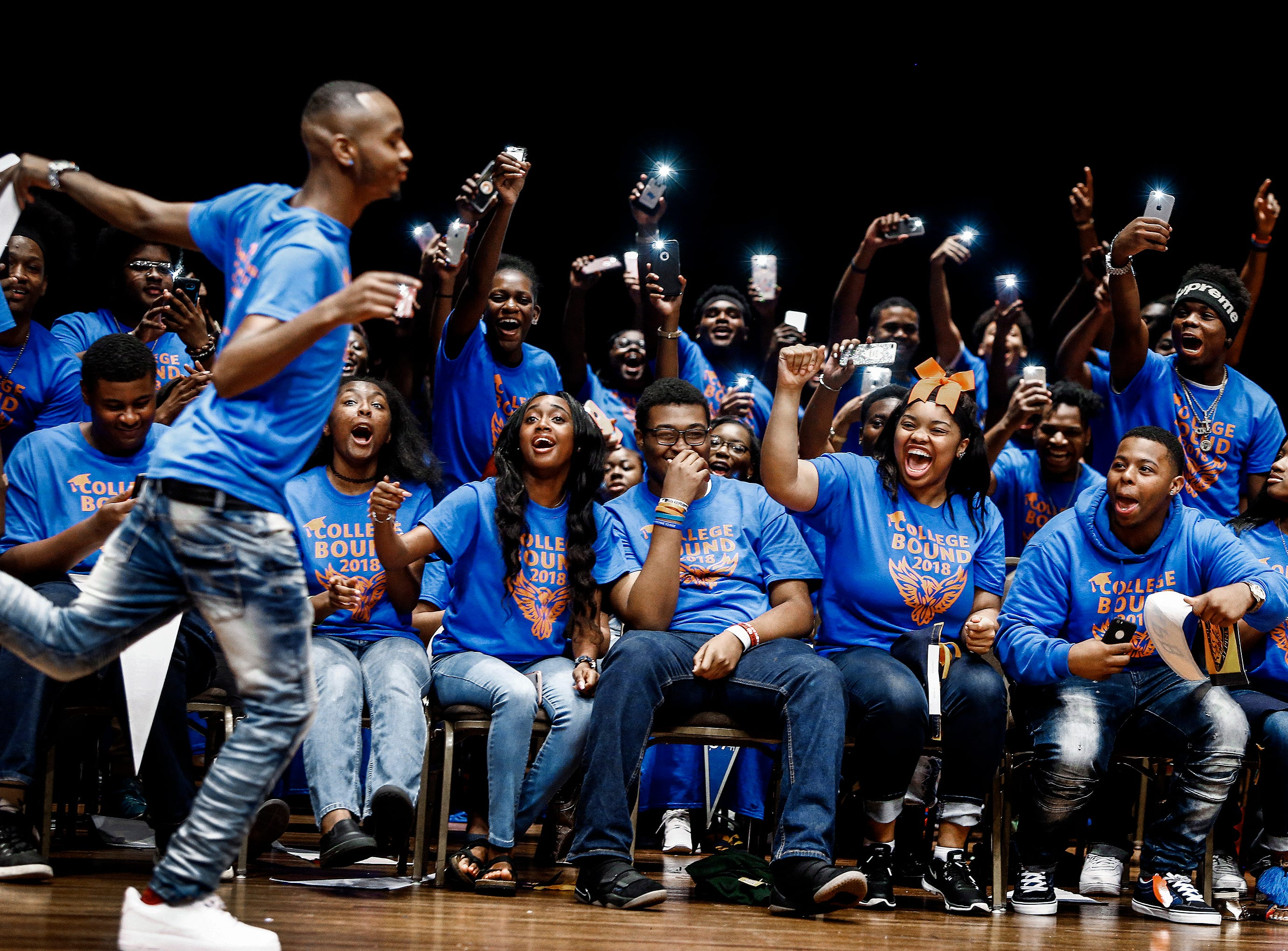 As his KIPP:Memphis Collegiate High School classmate cheer him on senior Johnathan Phillips dances to the microphone to announce his college of choice during the school's Decision Day 2018 at The Cannon Center.