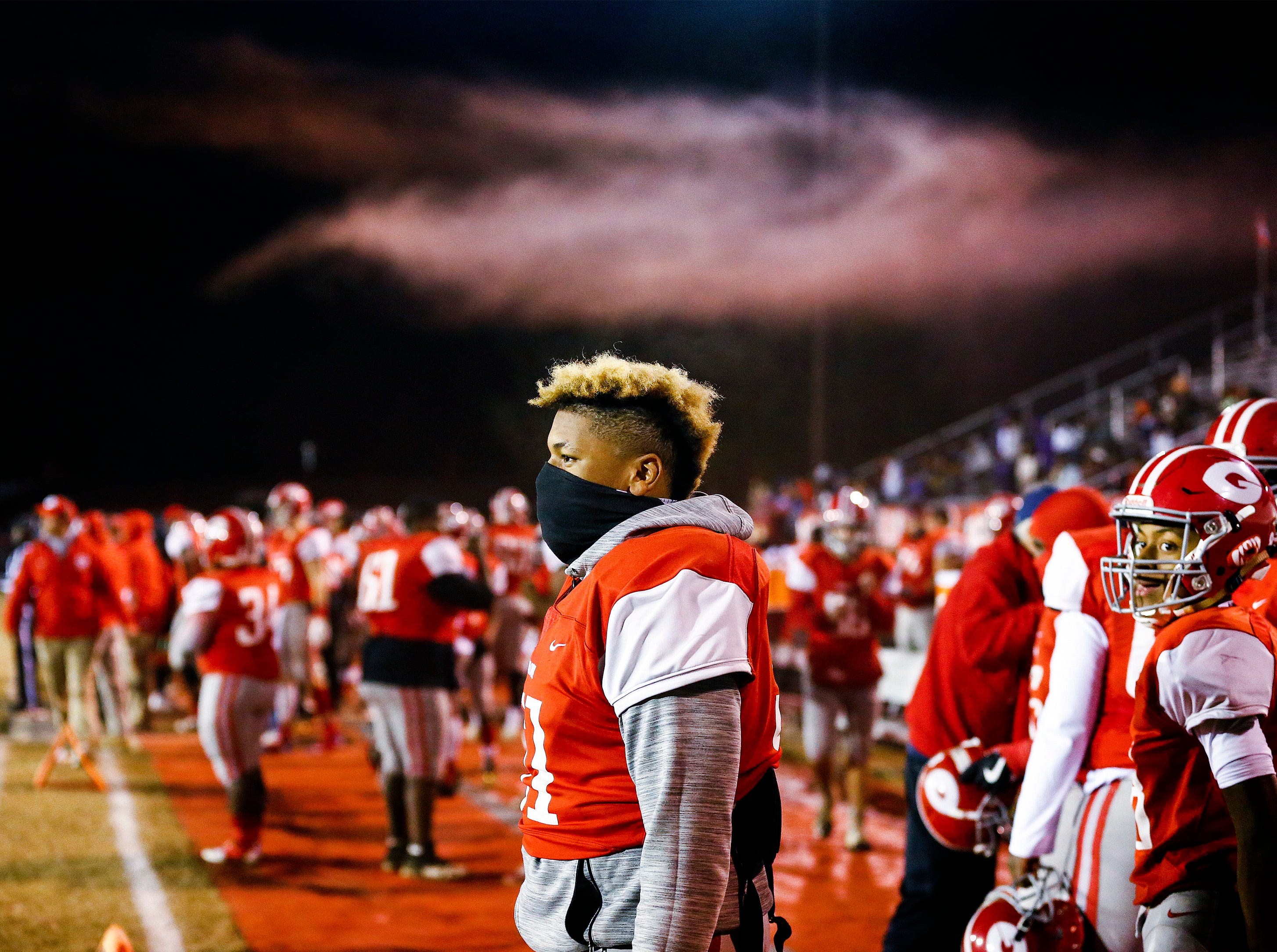 Germantown's Damian Hairston (middle) on the sidelines before taking on Whitehaven during action of their 6A state semifinal game in Germantown, Tenn.