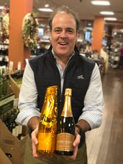 Buster's Liquors & Wines owner Josh Hammond holds his top two bubbly picks — one a splurge and one a bargain — for New Year's Eve.