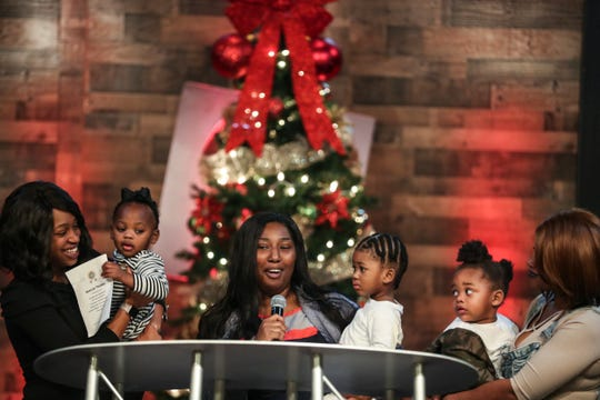 Brittany Seay, center, holds her son, Kyrie, speaks during the first graduation for the Agape Thrive by Five program on Tuesday. Agape is a local nonprofit agency which works with children and parents to promote brain development.