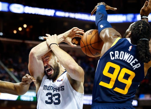 Memphis Grizzlies center Marc Gasol (left) is fouled by Utah Jazz defender Jae Crowder (right) during action at the FedExForum in Memphis, Tenn., Monday, November 12, 2018.
