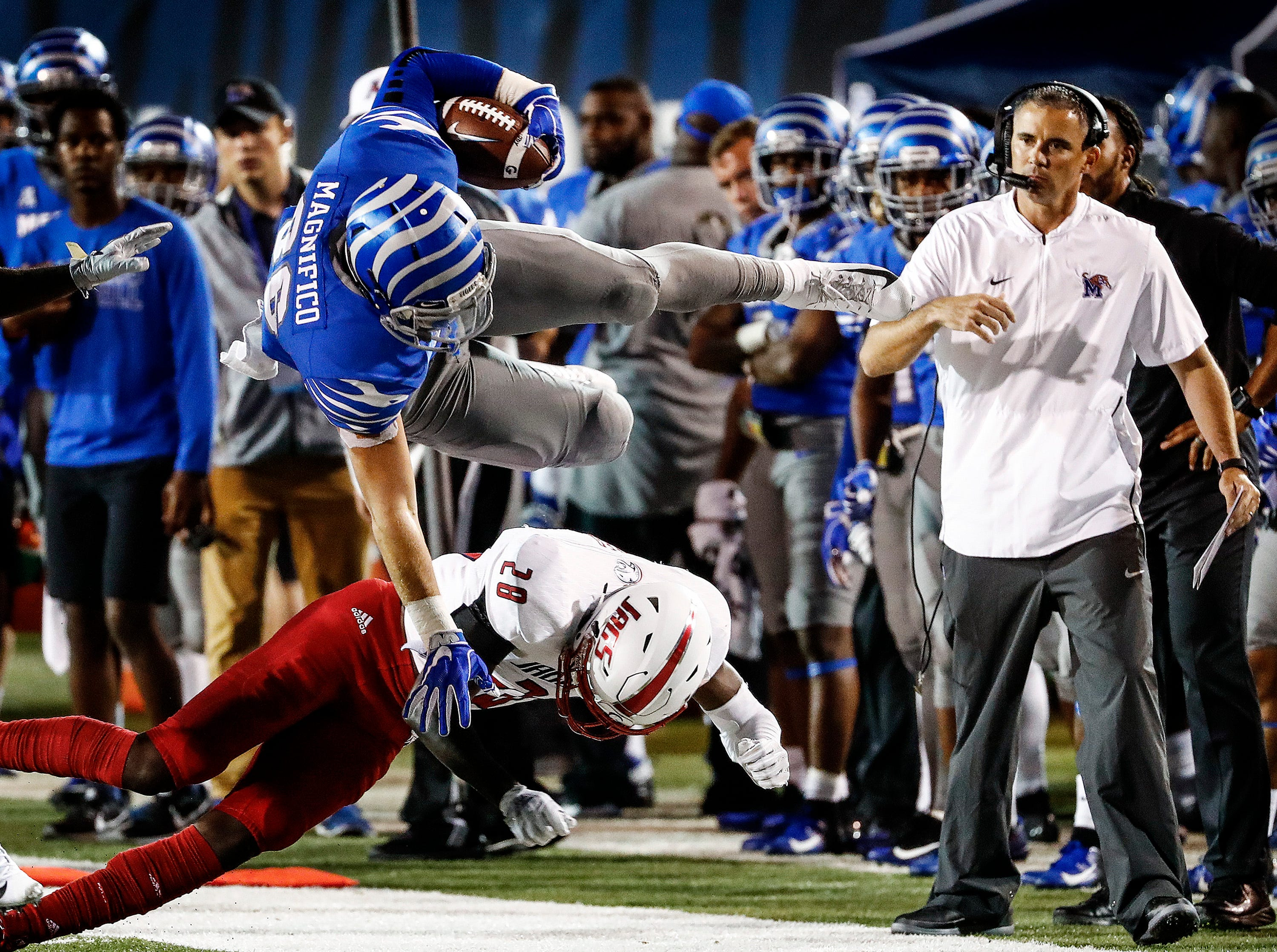 Memphis tight end Joey Magnifico (top) dives over South Alabama defender Travis Reed (bottom) after gaining a first down during action in Memphis, Tenn., Saturday, September 22, 2018.