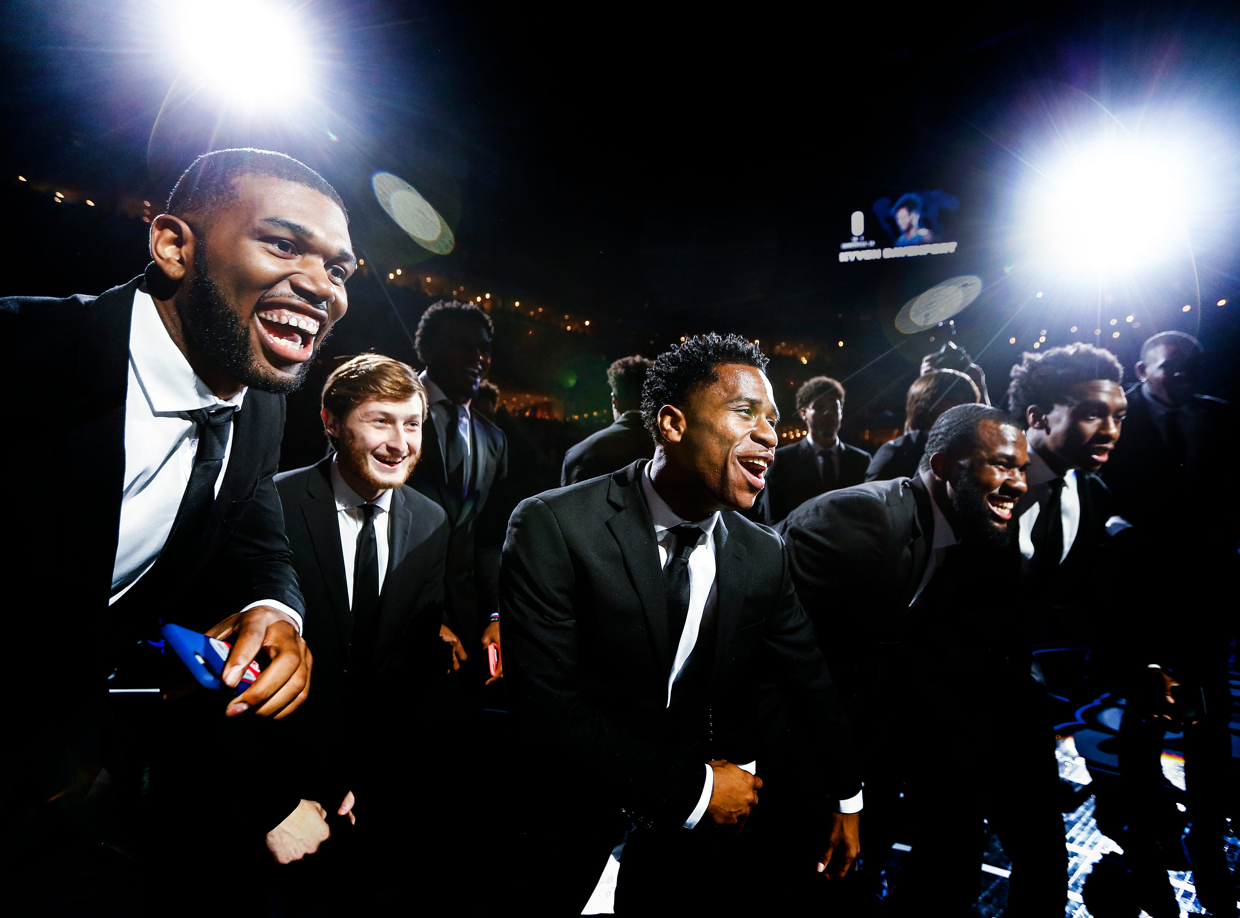 Tyler Harris (middle) dances with his teammates during Memphis Madness at the FedExForum Thursday evening.