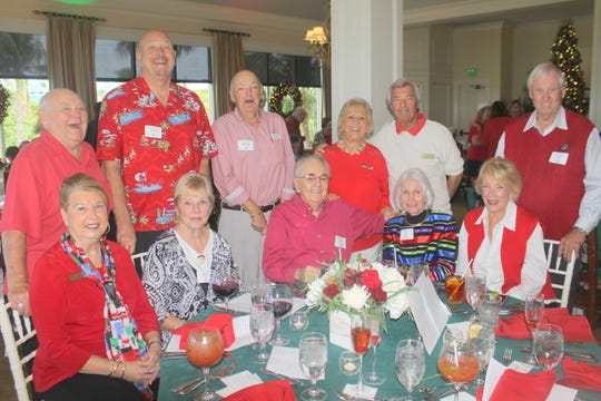Spreading holiday cheer are, seated: Rachel DeHanas, Ann Moore, Bob Marks, Sue Marks and Litha Berger; standing: Jack DeHanas, Steve Moore, Randle Grossman, Bonnie Bozzo, Al Bozzo and Jim Lane.