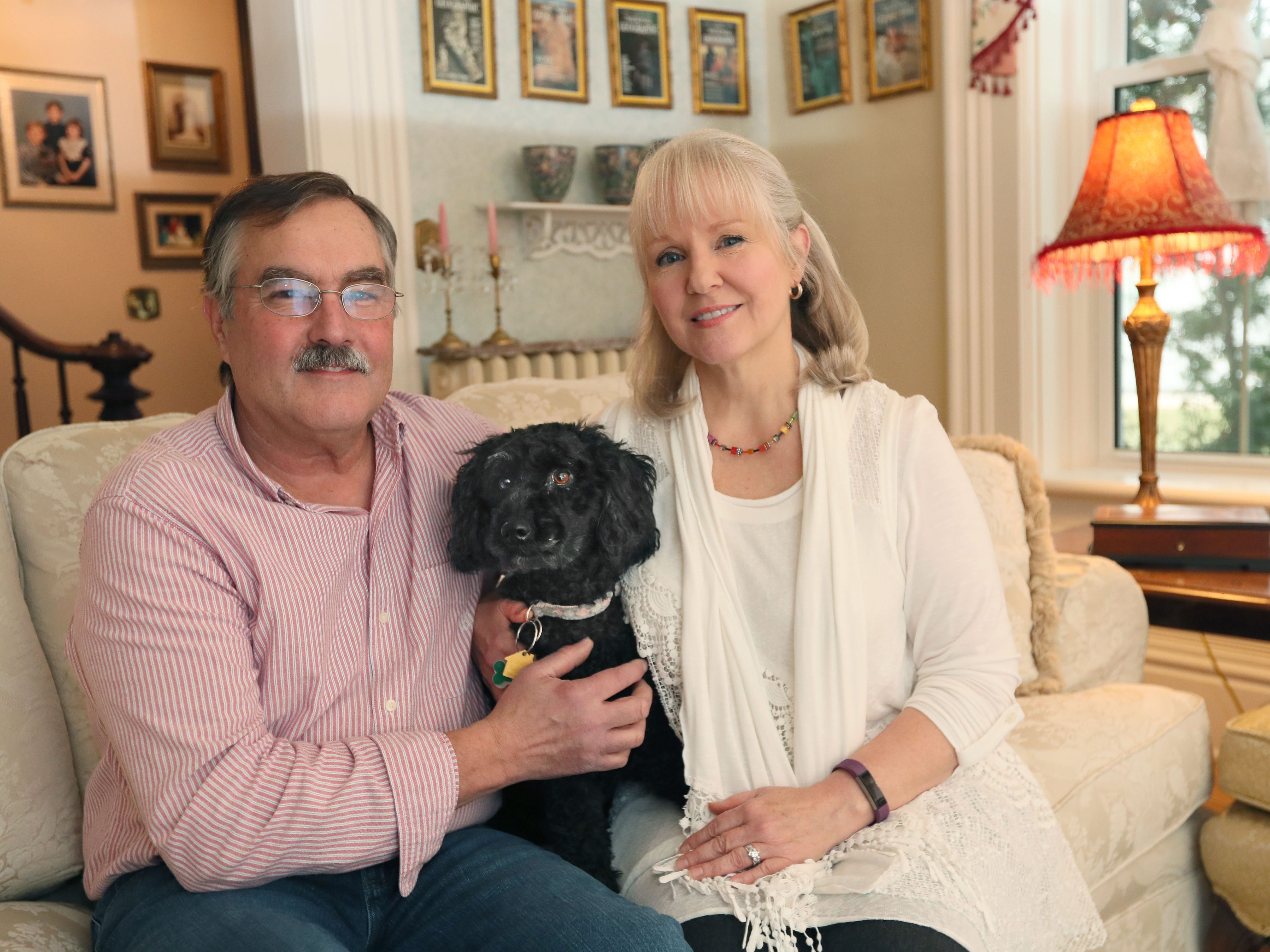 Peter and Dionne Kelm are shown here in the parlor with their dog Winnie.