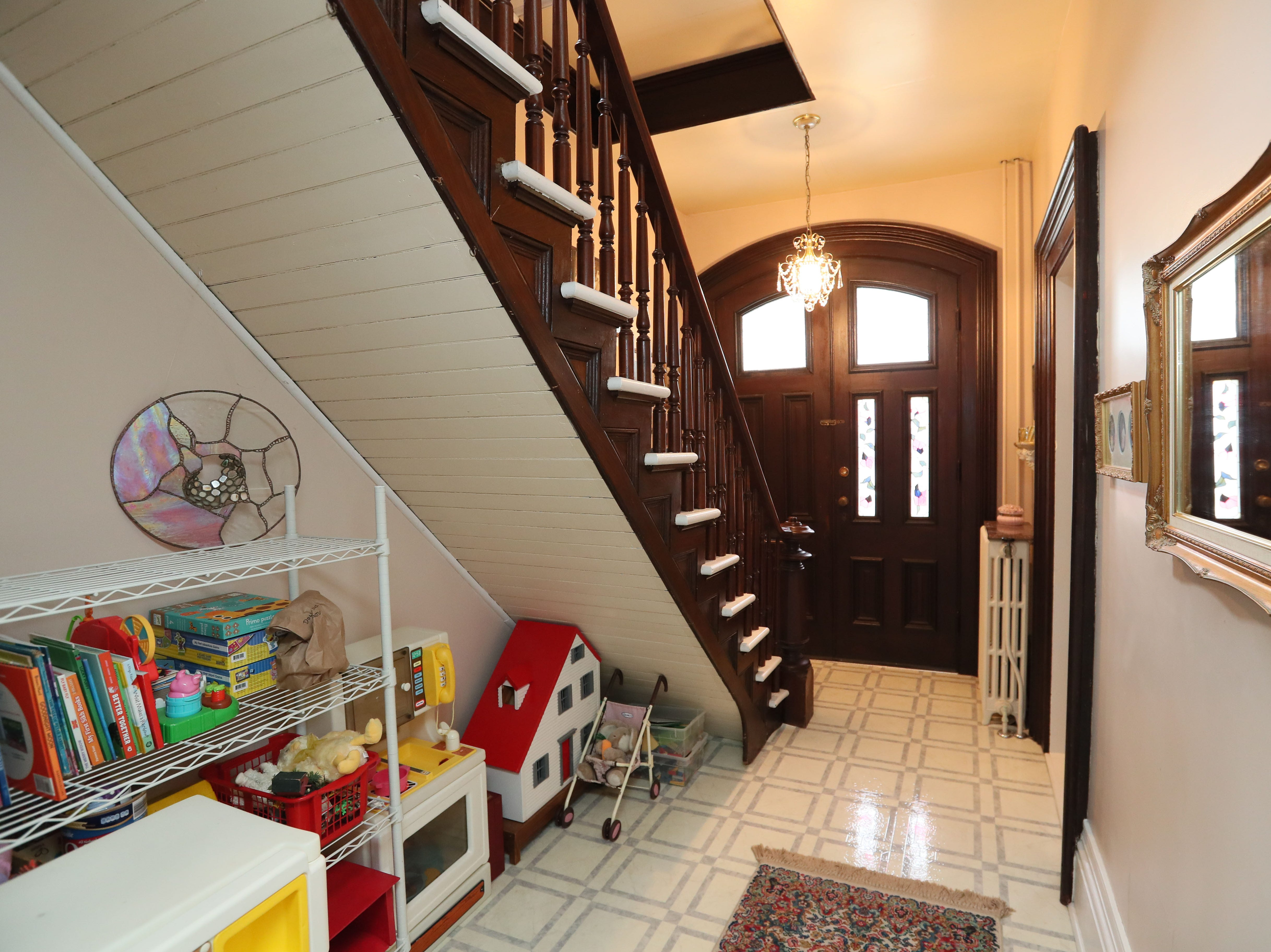 The space under a staircase to the second floor has toys for the grandkids to use.