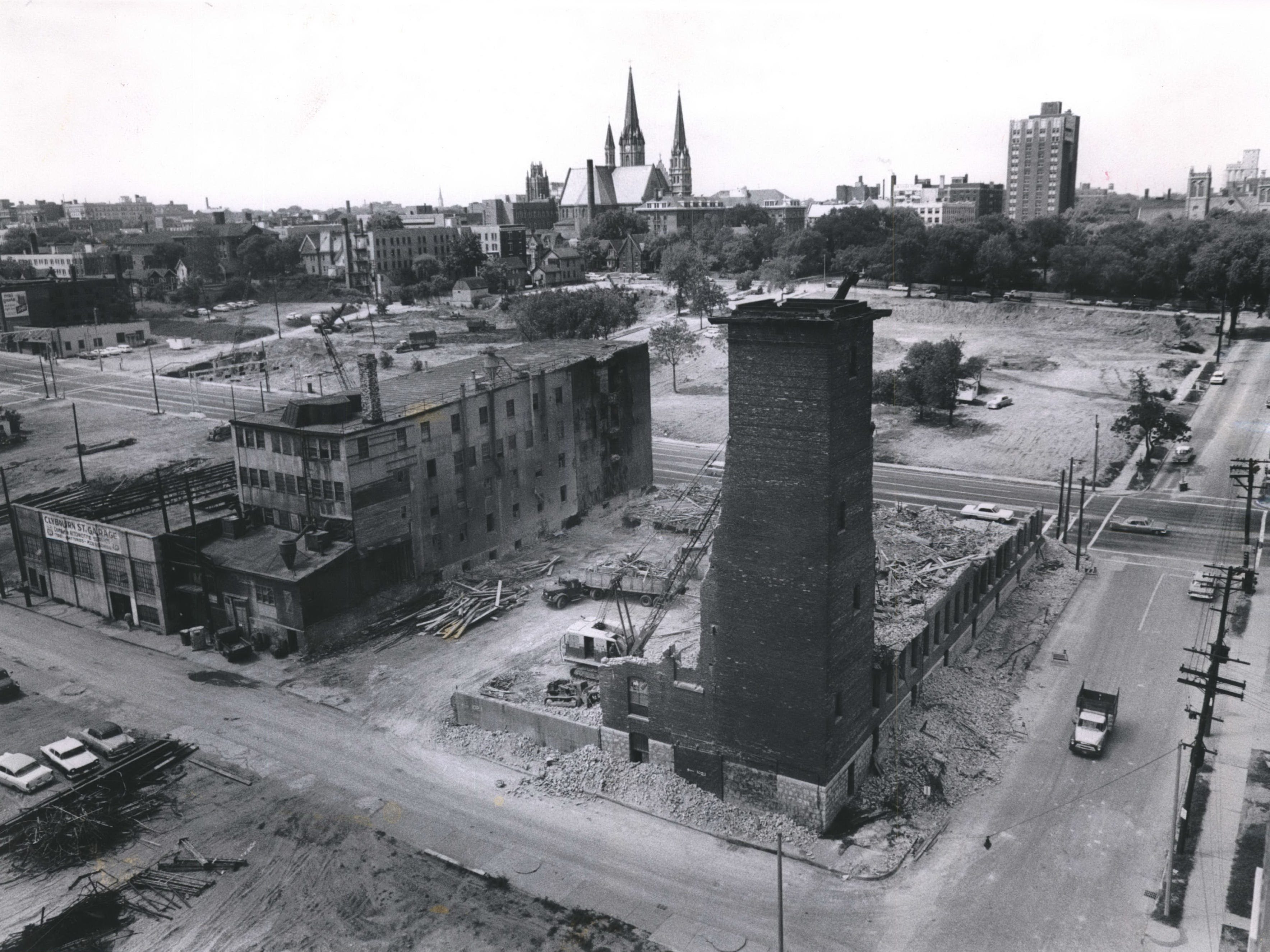 The spaces get a lot more wide open in downtown Milwaukee in 1964 as demolition continues to clear the way for the new Central Interchange linking freeways going east, west, north and south to and from Milwaukee. This was at N. 10th and W. Clybourn streets. The tall spires in the background are from Gesu Church. This photo was published in the June 4, 1964, Milwaukee Journal.