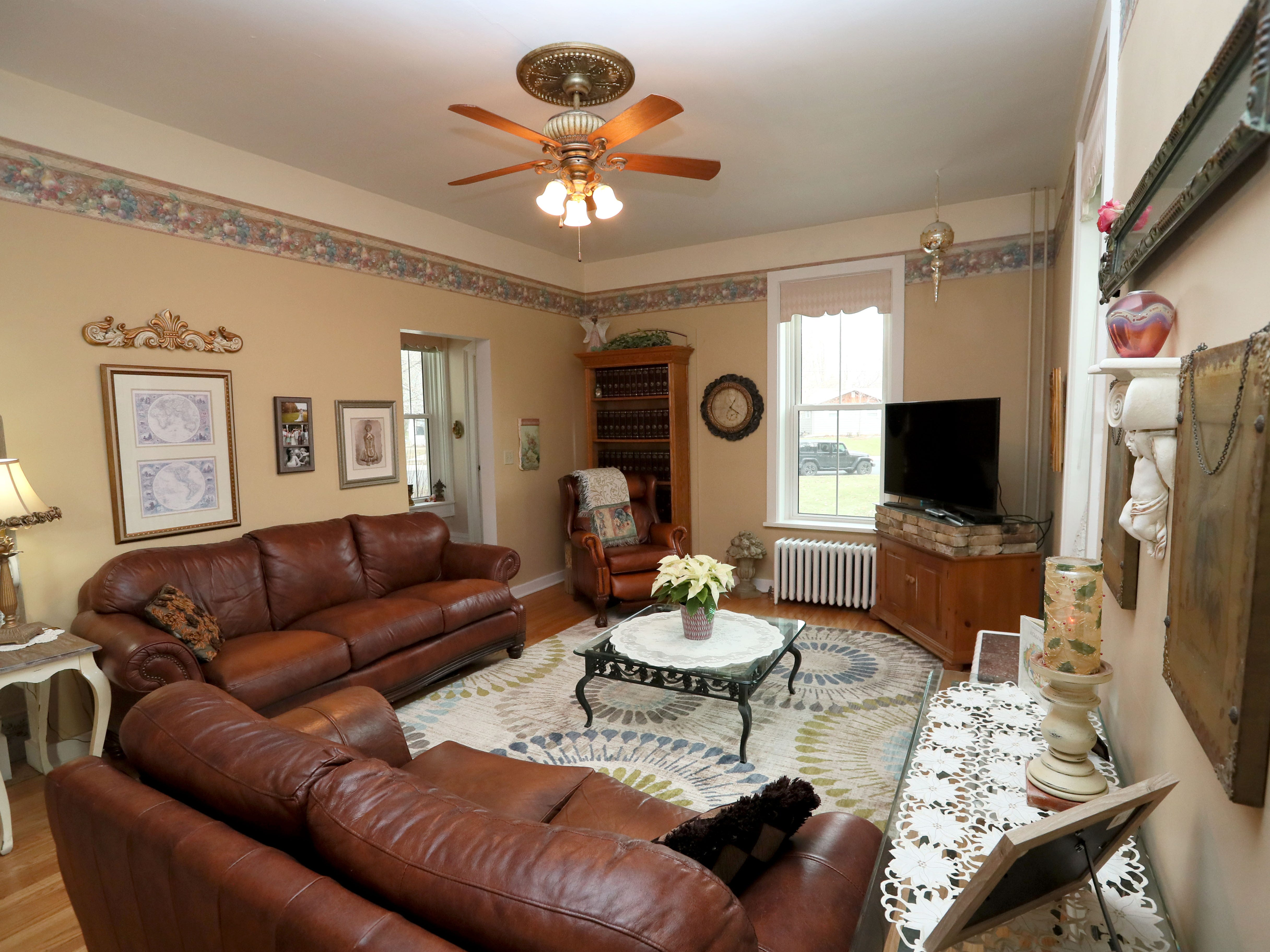 The couple likes spending time in the family room, with its comfy leather sofas.