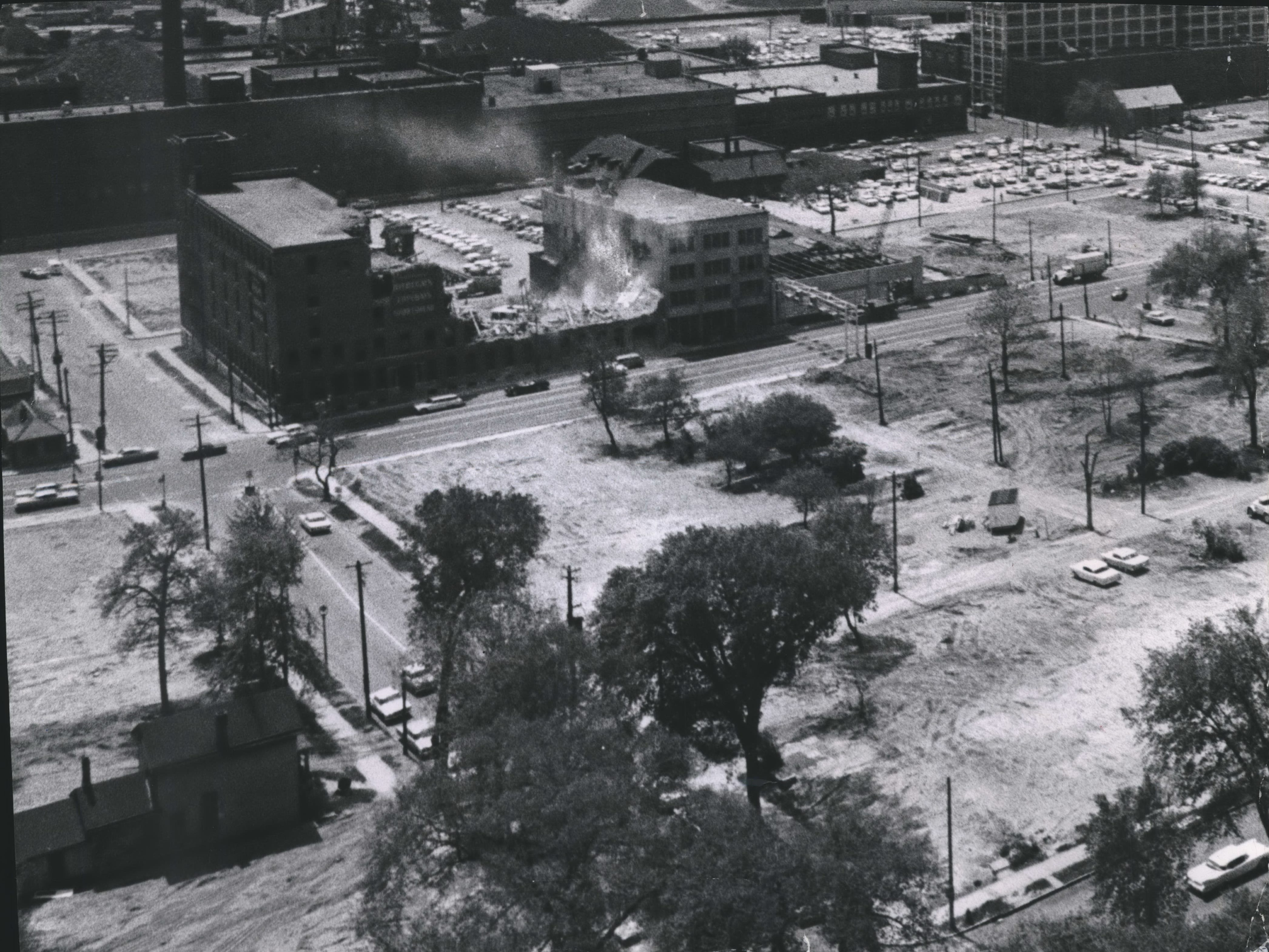 Wreckers demolish the former Cohen Brothers Clothing Co. building at W. Clybourn and N. 10th streets on May 21, 1964. The building, like the surrounding empty lots, was being cleared to make way for construction of the Central Interchange. The Cutler-Hammer plant, also a target of the project, is to the right of the Cohen Brothers building. This photo was published in the May 22, 1964, Milwaukee Journal.