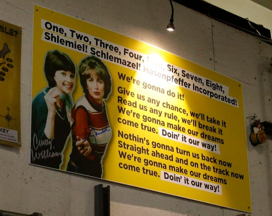 "A sign with the lyrics from the theme song from ""Laverne & Shirley"" is on the wall at Lakefront Brewery. 'One, two, three, four, five, six, seven, eight' schlemiel, schlimazel, hasenpfeffer incorporated!' sing guests on a tour of the Lakefront Brewery."
