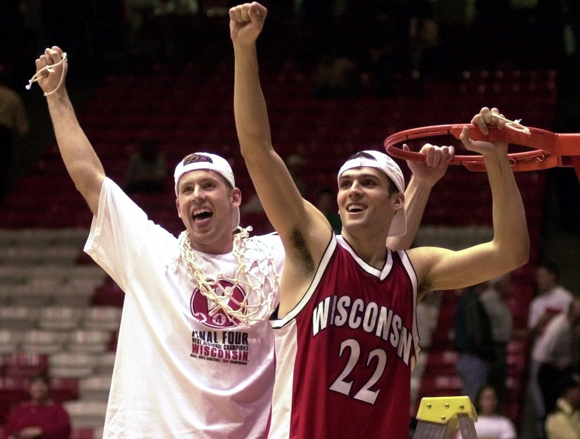 Wisconsin's Jon Bryant, left, and Mike Kelley (22) celebrate after cutting down the nets following Wisconsin's 64-60 NCAA West Regional win over Purdue Saturday, March 25, 2000.