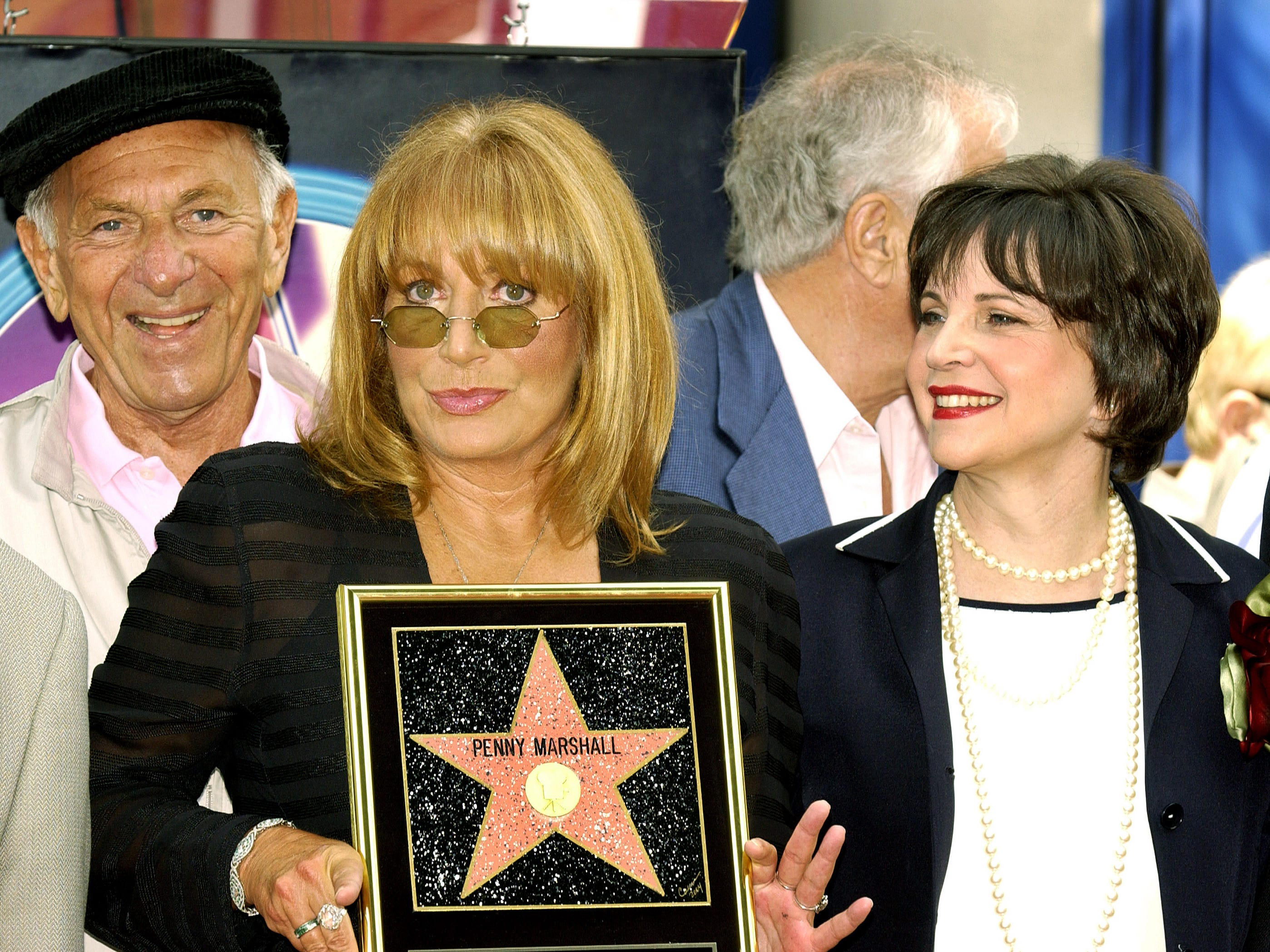 Actress, director and producer Penny Marshall and Cindy Williams attend the ceremony honoring each actress with a star on the Hollywood Walk of Fame on Aug. 12, 2004 in Hollywood, California.