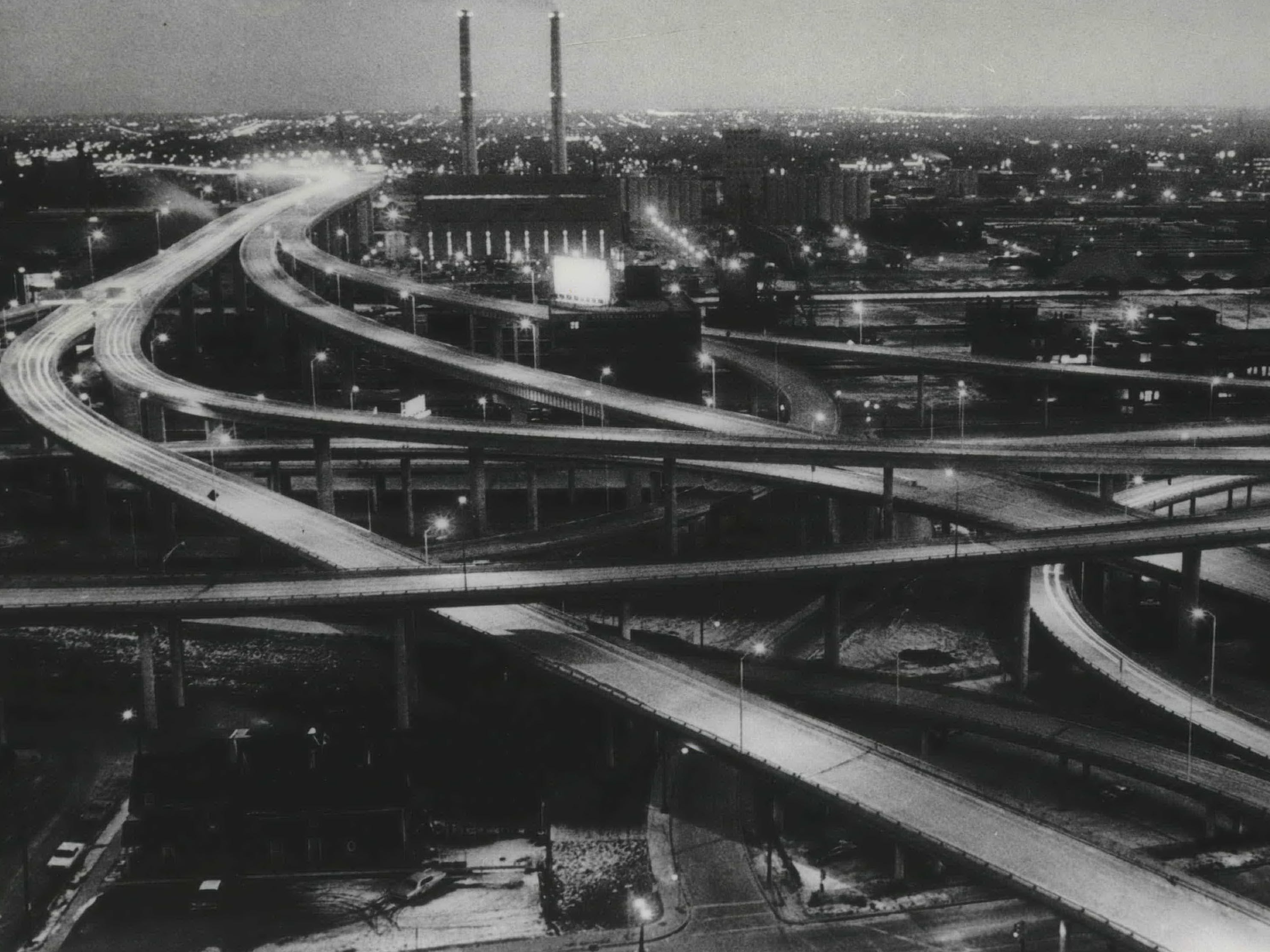 Twinkling lights stretch for miles to the south along the newly opened segments of Milwaukee's freeway system on Dec. 24, 1968. This picture, taken from the top of the YMCA building, 915 W. Wisconsin Ave., shows the Marquette Interchange and the Menomonee Valley High-Rise Bridge. The freeway sections opened to the public Dec. 23, 1968; this photo was published in the Dec. 25, 1968, Milwaukee Sentinel.